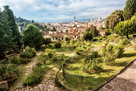 giardino: View from Giardino delle Rose to the city of Florence. Tuscany, Italy. Travelling scene. Beauty photo filter. Greenery and town. Cradle of the renaissance. Cultural heritage. Stock Photo