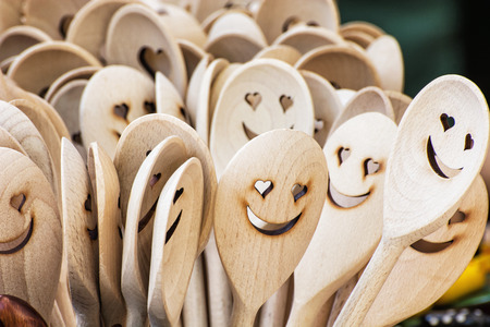 Carved wooden spoons. Kitchen utensil. Iconic faces. Stock fotó