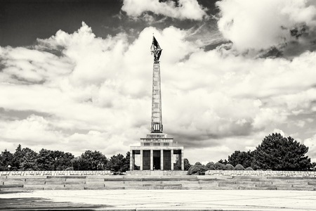military cemetery: Slavin is the memorial monument and military cemetery in Bratislava, the capital of Slovak republic. Cultural heritage. Architectural theme. Historical object. Black and white photo. Russian soldier statue and cloudy sky. Stock Photo