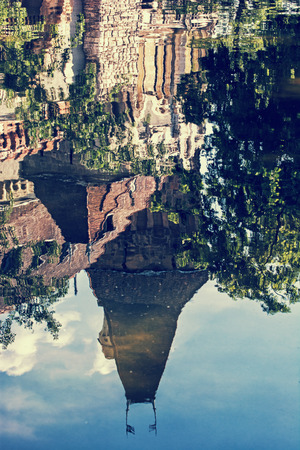 famous place: Beautiful Vajdahunyad castle is reflected in the water of the lake, Budapest, Hungary. Cultural heritage. Travel destination. Vertical composition. Famous place. Vintage photo filter. Architectural theme.