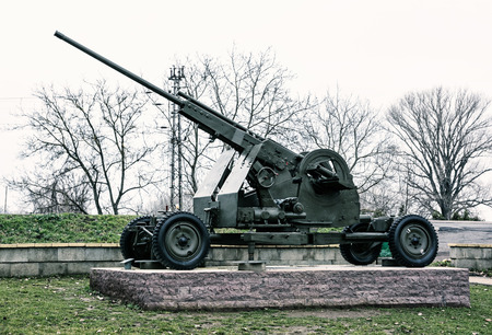 militarily: Anti-aircraft machine gun of the World war II. War industry. Cold photo filter. Biggest war campaign of 20th century. Weapons theme. Exposed artillery. Editorial