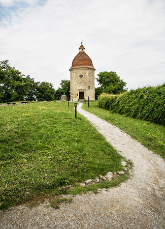rotunda: Romanesque rotunda with footpath in Skalica, Slovak republic. Architectural theme. Cultural heritage. Travel destination. Vertical composition. Stock Photo