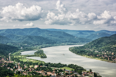 visegrad: View from Ruin castle of Visegrad, Hungary. Danube river. Travel destination. Sightseeing cruises. Forests, clouds and flowing water.