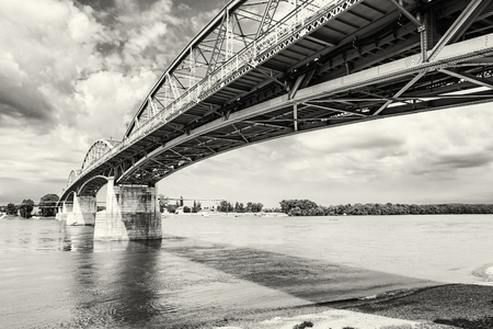 Maria Valeria bridge joins Esztergom in Hungary and Sturovo in Slovak republic across the Danube river. Architectural scene. Black and white photo. Transportation theme. Stock Photo
