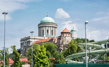 water   slide: Beautiful basilica and water slide in the thermal spa and baths in Esztergom, Hungary. Cultural heritage. Travel and recreation. Leisure activity.