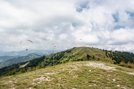 adrenaline: Paragliding, Donovaly, mountains scene, Slovak republic. Leisure activities. Seasonal natural theme. Beauty in nature. Adrenaline sport.