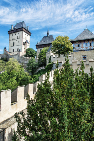 gothic castle: Karlstejn is a large gothic castle founded 1348 by Charles IV in Czech republic. Ancient architecture. Travel destination. Vertical composition. Editorial