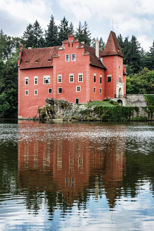 mirrored: Cervena Lhota is a beautiful chateau in Czech republic. It stands at the middle of a lake on a rocky island. Travel destination. Beautiful place. Vertical composition. Mirrored architecture. Editorial