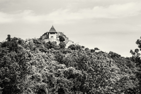 visegrad: Ruin castle of Visegrad, Hungary. Ancient architecture and forest. Travel destination. Black and white photo. Cultural heritage. Stock Photo