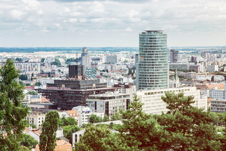 pyramid shape: Urban scene in Bratislava, capital of Slovak republic. Slovak radio building. Architectural theme. Retro photo filter. Inverted pyramid shape. Travel destination.
