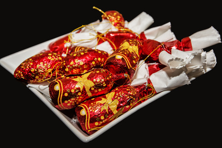 symbolic: Red christmas candies on the white plate. Symbolic food. Christian holiday.