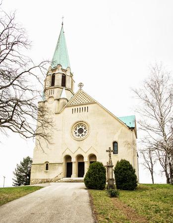 saint stephen cathedral: Roman catholic church of saint Stephen king, Nove Sady village, Slovak republic. Vertical composition. Religious architecture. Jesus Christ.