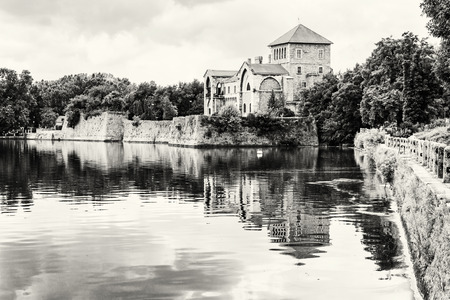 Beautiful castle in Tata, Hungary. Travel destination. Architectural theme. Beautiful place. Black and white photo. Fortress is reflected in the lake. Redakční
