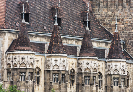 famous place: Close up photo of Vajdahunyad castle in Budapest, Hungary. Cultural heritage. Travel destination. Architectural scene. Famous place. Tourism theme. Editorial