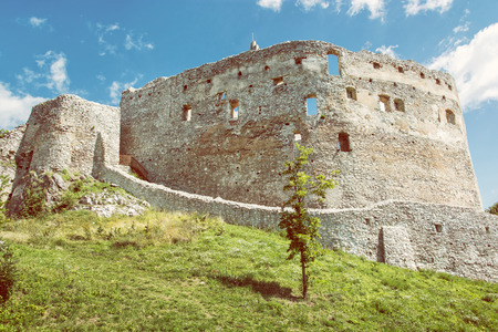 central europe: Ruin castle of Topolcany, Slovak republic, central Europe. Ancient architecture. Yellow photo filter. Beautiful place. Travel destination. Stock Photo