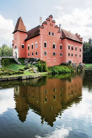 Cervena Lhota is a beautiful chateau in Czech republic. It stands at the middle of a lake on a rocky island. Travel destination. Mirrored architecture. Editorial
