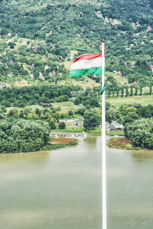 visegrad: View from ruin castle of Visegrad, Hungary. Hungarian flag and Danube river. Travel destination. Vertical composition.