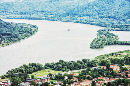 visegrad: View from Ruin castle of Visegrad, Hungary. Danube river. Travel destination. Sightseeing cruises. Forests and flowing water.