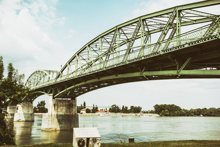 joins: Maria Valeria bridge joins Esztergom in Hungary and Sturovo in Slovak republic across the Danube river. Transportation theme. Architectural scene. Stock Photo