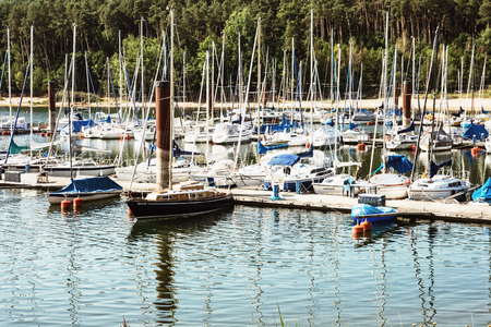 a bathing place: Many sailboats at the pier in Brombachsee, Germany. Summer vacation. Travel destination. Beautiful place.