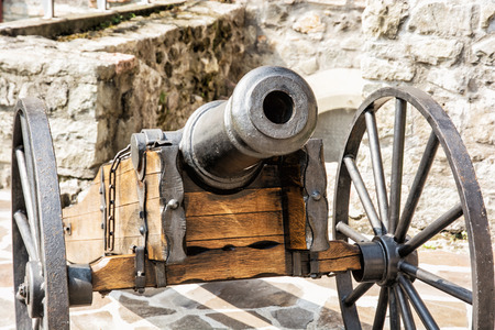 gunfire: Close up photo of historic cannon. Retro object. Military theme.