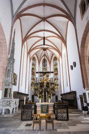 Interior of Saint Johannes and Saint Martin church, Schwabach, Bavaria, Germany. Jesus Christ on the cross. Vertical composition. Christian altar.