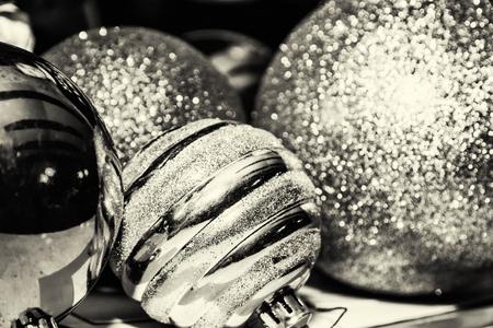 symbolic: Shimmering christmas baubles. Symbolic objects. Xmas decoration. Black and white photo.