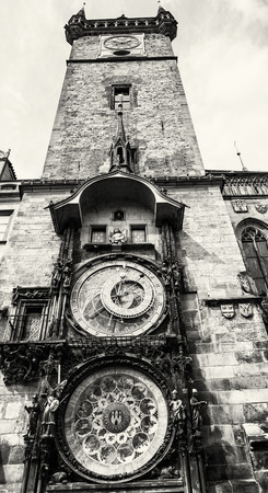 old town hall: Old town hall with astronomical clock in Prague. Cultural heritage. Architectural theme. Vertical composition. Travel destination. Black and white photo. Stock Photo