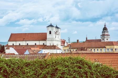 Jesuit church and Parish church of saint archangel Michael in Skalica, Slovak republic. Place of worship. Cultural heritage. Retro photo filter. Travel destination. Stock Photo