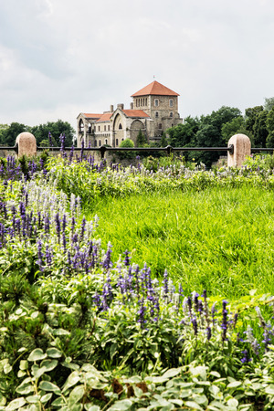 Ancient castle in Tata, Hungary. Travel destination. Architectural theme. Beautiful fortress and seasonal flowers. Redakční