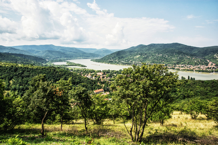 visegrad: View from Ruin castle of Visegrad, Hungary. Greenery and Danube river. Travel destination. Sightseeing cruises. Forests, clouds and flowing water. Editorial
