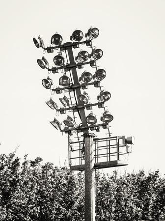 vertical composition: Stadium lighting scene. Electrical equipment. Sport theme. Black and white photo. Vertical composition. Stock Photo