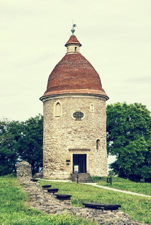 vertical composition: Romanesque rotunda in Skalica, Slovak republic. Architectural theme. Cultural heritage. Retro photo filter. Travel destination. Vertical composition.