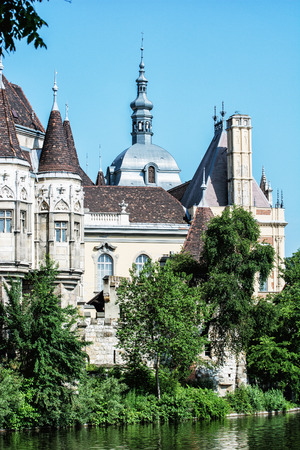 famous place: Beautiful Vajdahunyad castle with lake in Budapest, Hungary. Cultural heritage. Travel destination. Vertical composition. Famous place. Architectural theme. Editorial