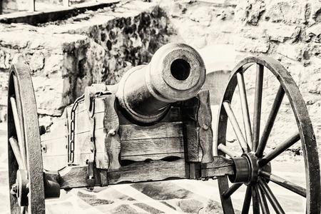 gunfire: Close up photo of historic cannon. Retro object. Military theme. Black and white photo. Stock Photo