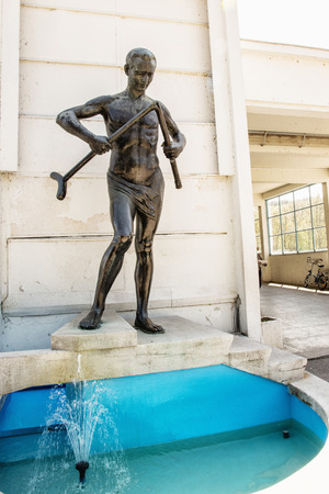 healthfulness: Crutch breaker statue, Piestany, Slovak republic. Famous spa. Symbolic object. Art scene. Vertical composition.