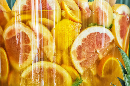 sliced orange: Sliced orange in juice. Tasty refreshment. Food and drink. Healthy lifestyle. Vibrant colors. Stock Photo