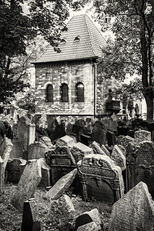 jewish houses: Jewish cemetery in Prague, Czech republic. Historical object. Memorial place. Many graves. Vertical composition. Black and white photo. Stock Photo