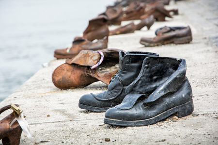 Shoes monument on the Danube bank is a memorial in Budapest, Hungary. Place of reverence. Cultural heritage. Symbolic artistic object. Stock Photo