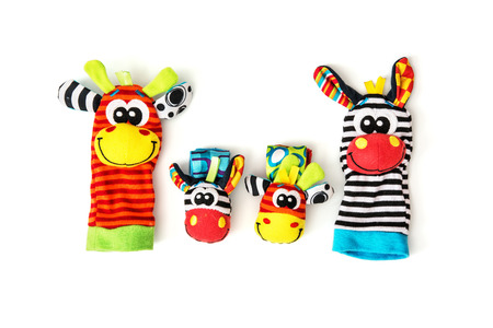 vibrant colors fun: Colorful hand puppets and wrist pals on the white background. Funny toys. Vibrant colors. Stock Photo