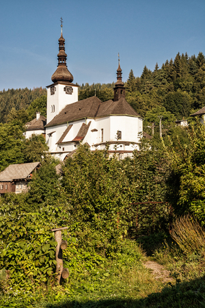vertical composition: Fortified church in Spania Dolina, Slovak republic. Travel destination. Religious architecture. Beautiful place. Yellow photo filter. Vertical composition.