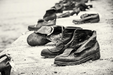 massacre: Shoes monument on the Danube bank is a memorial in Budapest, Hungary. Place of reverence. Black and white photo. Symbolic artistic object. Stock Photo