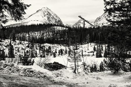 Solisko peak with springboard for ski jumping, Strbske pleso, Slovak republic. Winter mountains. Black and white photo. Foto de archivo