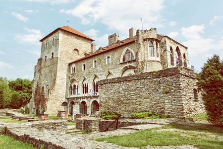 Beautiful castle in Tata, Hungary. Travel destination. Architectural theme. Retro photo filter. Historic object. Redakční