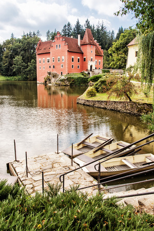 Cervena Lhota chateau with small boats in the lake, Czech republic. Travel destination. Photo filter. Stock Photo