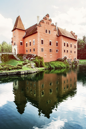 Cervena Lhota is a beautiful chateau in Czech republic. It stands at the middle of a lake on a rocky island. Retro photo filter.