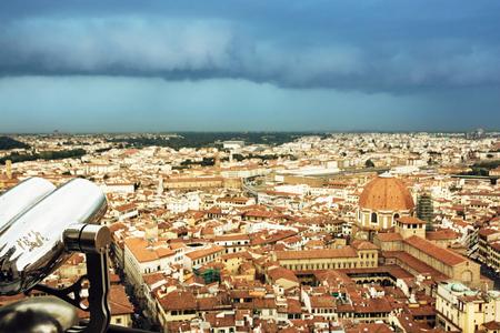 Storm over the Florence city, Tuscany, Italy. Retro photo filter. Urban scene.