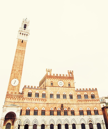 Palazzo Pubblico - town hall is the palace in Siena, Tuscany, central Italy. Travel destination. Photo filter.