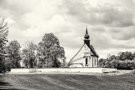 Chapel of Our Mother God near Veveri castle, Moravia, Czech republic. Religious architecture. Travel destination. Black and white photo.