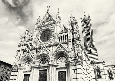 earliest: Siena cathedral is a medieval church in Siena, Italy, dedicated from its earliest days as a Roman Catholic Marian church. Black and white photo.